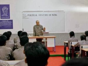 President Pranab Mukherjee teaching students at a Government School