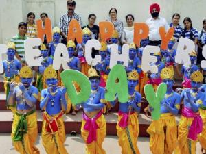 Students dressed up as Lord Krishna celebrate Teacher's Day