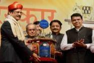 President Pranab Mukherjee presents the Punyabhushan Award to Prataprao Pawar in presence of Rao and Devendra Fadnavis and Sharad Pawar