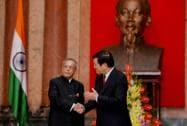 President Pranab Mukherjee shakes hands with his Vietnamese counterpart Truong Tan Sang at a meeting