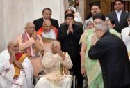 President Pranab Mukherjee greets scholars during the Presidential Award function at Rashtrapati Bhavan