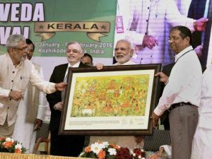 Prime Minister Narendra Modi is presented with a memento at the Global Ayurveda Festival  in Kozhikode