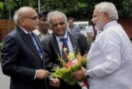 PM Narendra Modi being received by the Secretary DAE and Chairman, AEC, R K Sinha