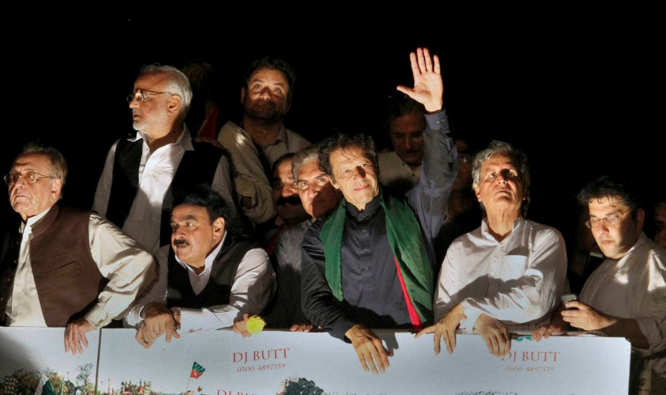 Pakistan's, cricketer, turned, politician, Imran Khan, waves, supporters, leads, march, toward, parliament