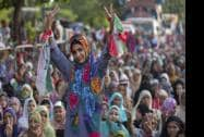 A supporter of Pakistani religious cleric Tahir-ul-Qadri flashes victory signs during an anti-government protest in Islamabad