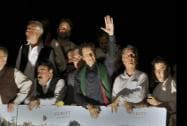 Pakistan's cricketer-turned-politician Imran Khan waves to supporters as he leads a march toward parliament