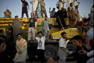 Supporters of Pakistani cricketer-turned-politician Imran Khan dance on the lyrics of a song in Khan's support