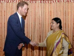 British Prince Harry, left, shakes hands with Nepalese President Bidhya Devi Bhandari, right, during a meeting at President residence in Kathmandu
