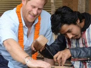 Prince Harry tries wood carving at heritage sites at Patan Durbar Square on the outskirts of Kathmandu, Nepal