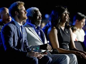 Britain's Prince Harry, from left, actor Morgan Freeman and first lady Michelle Obama listen to speakers during the opening ceremony for the Invictus Games