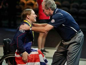 Former President George W. Bush congratulates United Kingdom powerlifter Nerys Pearce after her silver-medal performance at the Invictus Games at Disney's ESPN Wide World of Sports