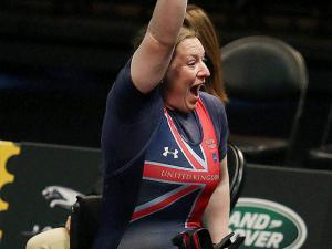 United Kingdom's Nerys Pearce celebrates her silver-medal-winning lift in the powerlifting competition at the Invictus Games at Disney's ESPN Wide World of Sports