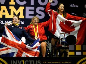 Winners in the women's heavyweight powerlift competition, from left, silver medaalist Nerys Pearce, of United Kingdom, gold medalist Canada's Christine Gauthier, of Canada, and bronze medalist Natacha Dupuis, of Canada