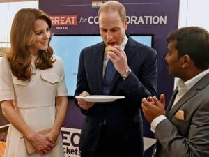 Prince William, Duke of Cambridge and Catherine, Duchess of Cambridge eats a dosa during the launch of 'Tech Rocketship Awards' in Mumbai.