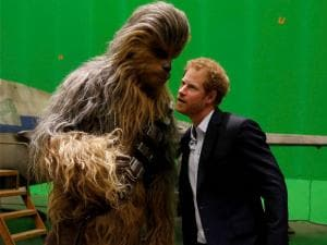 Prince Harry meets the character Chewbacca during a tour of the Star Wars sets at Pinewood studios in Iver Heath, west London