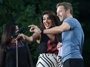 Priyanka Chopra and musician Chris Martin speak at the 2016 Global Citizen Festival