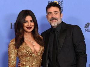 Priyanka Chopra and Jeffrey Dean Morgan pose in the press room at the 74th annual Golden Globe Awards