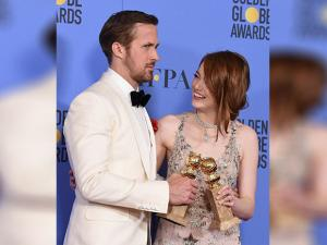 Ryan Gosling and Emma Stone pose in the press room