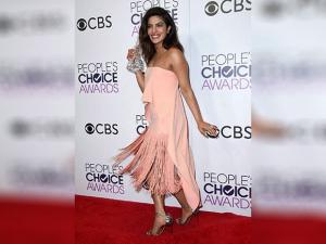 Priyanka Chopra poses in the press room with the award for favorite TV drama actress at the People's Choice Awards at the Microsoft Theater