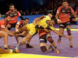 Players of U Mumbai (Red) and Telugu Titans(Yellow) in action during the Pro Kabaddi match in Mumbai