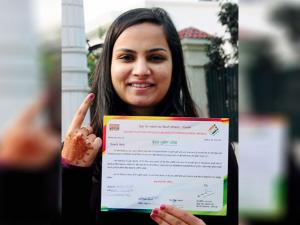 A girl showing  her indelible ink marked finger after casting vote at a polling station at Patiala