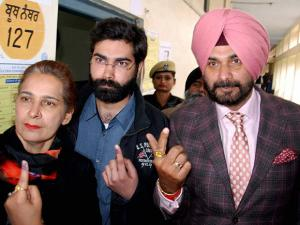 Congress candidate Navjot Singh Sidhu, along with his wife Navjot Kaur and his son, after casting their votes at a polling station