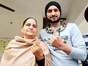 Cricketer Harbhajan Singh and his mother showing indelible ink marked on their fingers after casting their votes at a polling station in Jalandhar