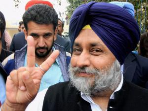 SAD president and Deputy Chief Minister Punjab Sukhbir Singh Badal showing a victory sign after casting his vote