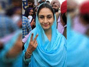 Union Food Processing Minister Harsimrat Kaur Badal showing a victory sign after casting her vote
