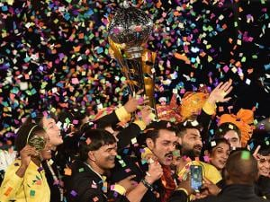 Punjab Royals co-owner Bobby Deol and players celebrate with Pro Wrestling League Season 2 Trophy after beat Haryana Hammers