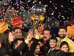 Punjab Royals co-owner Bobby Deol and players celebrate with Pro Wrestling League Season 2 Trophy after beat Haryana Hammers, in New Delhi