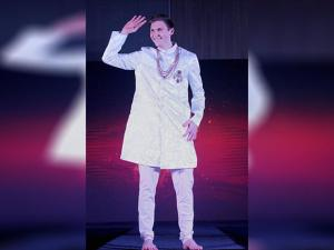 Denmark's badminton star Viktor Axelsen walks the ramp