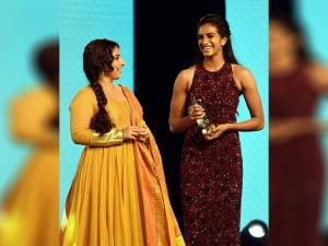 Indian badminton player P V Sindhu receives an award from Vidya Balan during the Times of India Sports Awards night (TOISA)