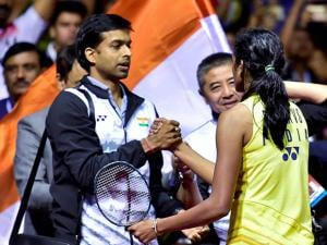 India's ace shuttler PV Sindhu celebrates with her coach P Gopichand after winning women's singles final