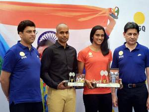 PV Sindhu and her coach Gopichand being felicitated by Chess legend Viswanathan Anand and billiard player Geet Sethi