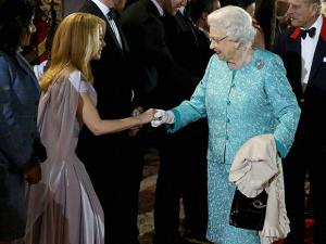 Britain's Queen Elizabeth II, right, greets singer Kylie Minogue during the televised celebration of her 90th birthday in the grounds of Windsor Castle in Berkshire