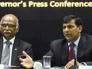 Raghuram Rajan along with deputy governor R Gandhi speaks at a press conference