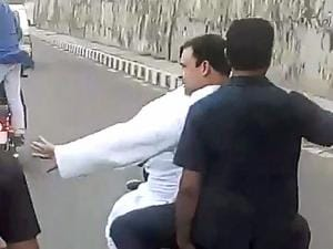 Rahul Gandhi rides pillion on a bike on his way to Madhya Pradesh's Mandsaur