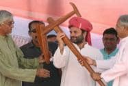 Congress Vice President Rahul Gandhi is presented a plough