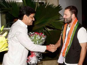Congress Vice President Rahul Gandhi is greeted by Maharashtra Pradesh Congress Committee (MPCC) President Ashok Chavan