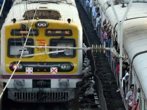 Commuters travel in suburban local trains of Western Railways on the eve of the Railway Budget in Mumbai