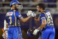 Rajasthan Royals' player Ajinkya Rahane greets Karun Nair for scoring half century
