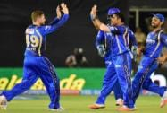 Rajasthan Royals players celebrate the wicket of  Unmukt Chand
