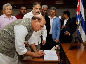 Rajnath Singh signs the Condolence Book at the Cuban Foreign Office in Havana