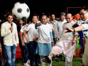 Union Home Minister Rajnath Singh kicks a  football