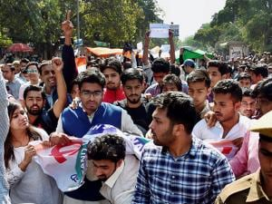 ABVP workers march with a giant tricolour during a protest in DU's Campus