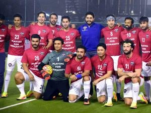 All Stars Football Club (ASFC) football team pose for a photo at a charity match organised by GS Worldwide Entertainment