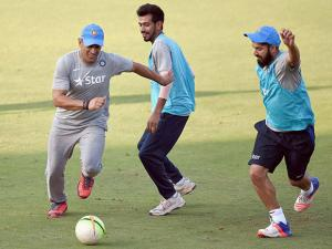 MS Dhoni alongwith team players during a practice session in Mumbai