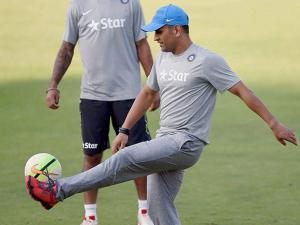 MS Dhoni and Shikhar Dhawan during a practice session in Mumbai
