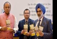 Union Finance Minister Arun Jaitley along with Gurdial Singh Sandhu, Secretary Financial Services, and LIC Chairman S K Roy